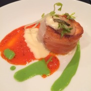 Scallop wrapped in salmon bacon.