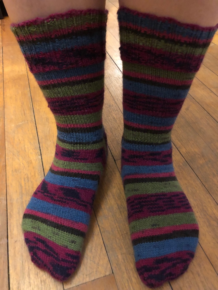 hand knit striped socks in pink, blue, and green