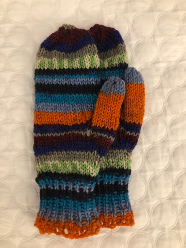 orange, blue, black, and green striped mittens